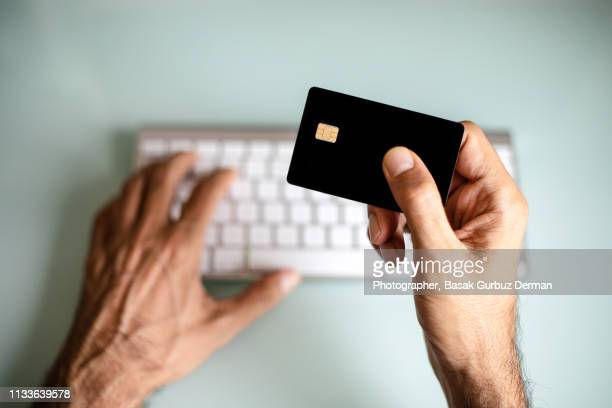 a man using credit card, online shopping / electronic banking - bank account stock pictures, royalty-free photos & images
