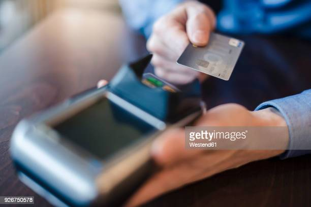 man using credit card reader, close-up - credit card reader stock pictures, royalty-free photos & images