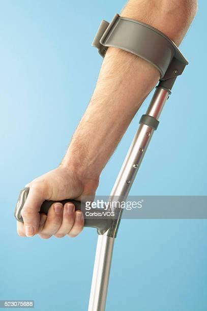 Man Using Crutch
