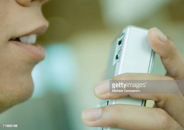 Man using dictaphone