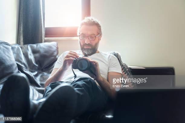 Man using digital camera at home