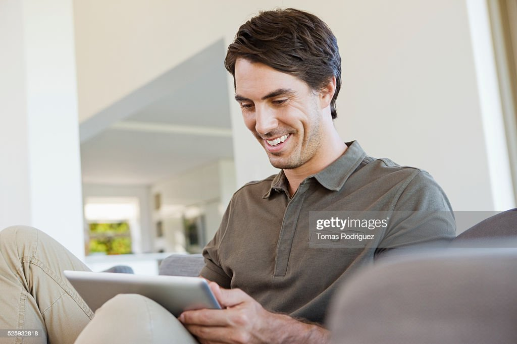 Man using digital tablet at home : Foto de stock