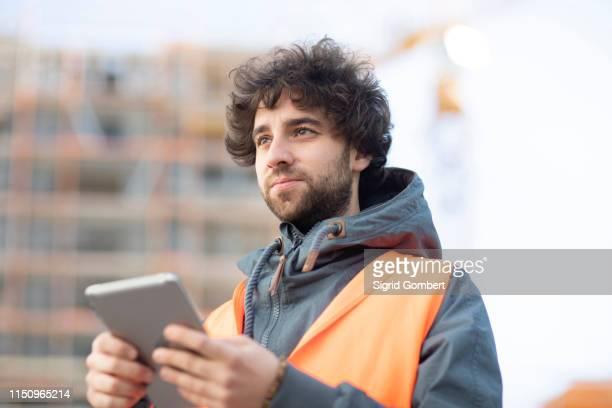 man using digital tablet on street - digital native stock-fotos und bilder