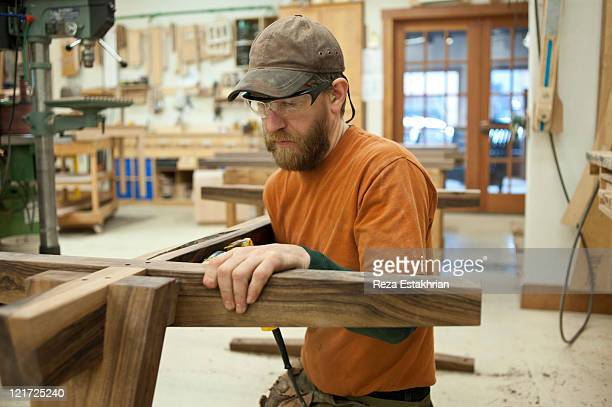 Man using drill to make a table
