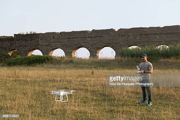 man using drone - remote control helicopter stock photos and pictures