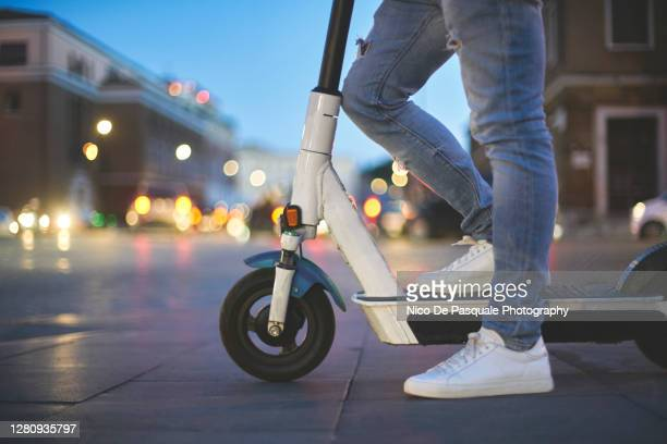 man using electric push scooter - tourist stock pictures, royalty-free photos & images