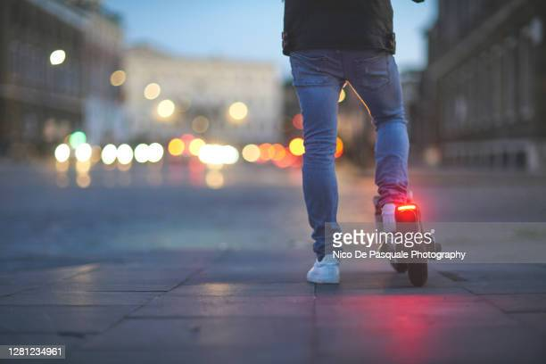 man using electric push scooter - traffic stock pictures, royalty-free photos & images