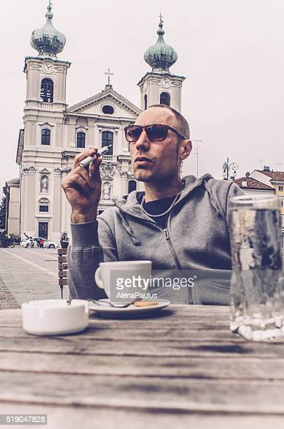 man using electronic cigarette and drinking coffee, bar in italy - gorizia stock pictures, royalty-free photos & images