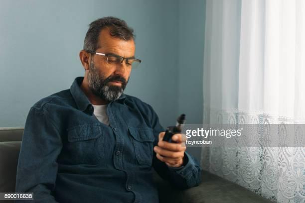 Man using electronic cigarette