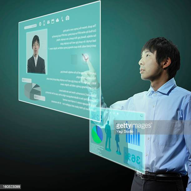 Man using Futuristic monitor