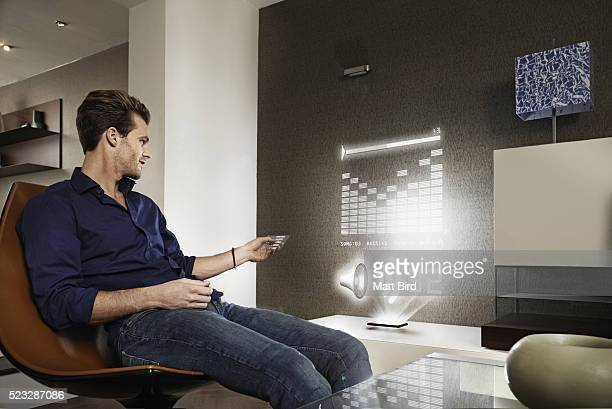 Man using futuristic music system