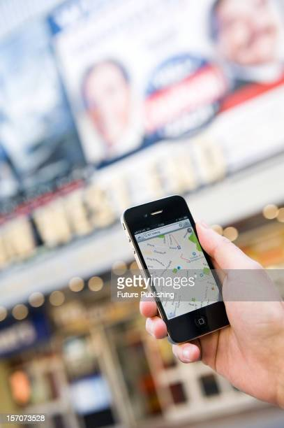 A man using Google Maps on an iPhone to find his way around London October 4 2012