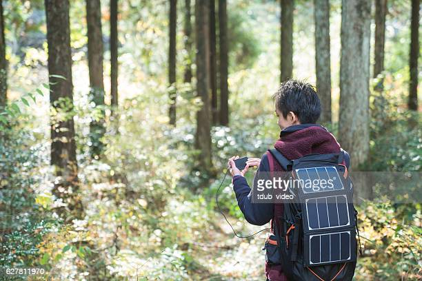 man using gps powered by solar panels in the forest - tdub_video stock pictures, royalty-free photos & images