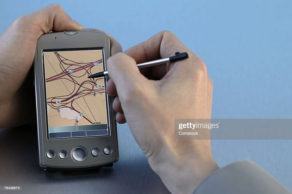 Man using GPS system : Stock Photo