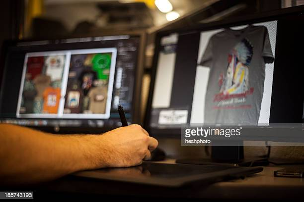 man using graphic tablet and pen to design t-shirt - heshphoto stock pictures, royalty-free photos & images