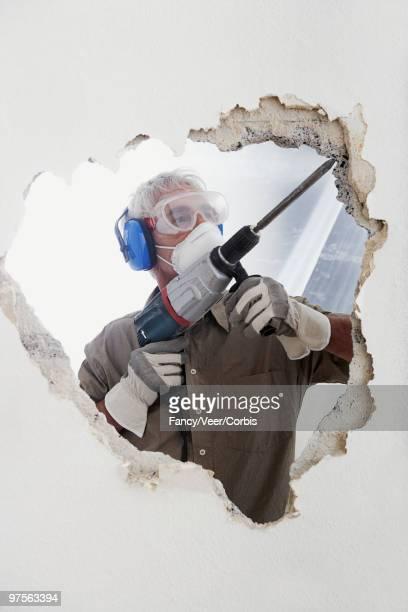 Man using hammer drill