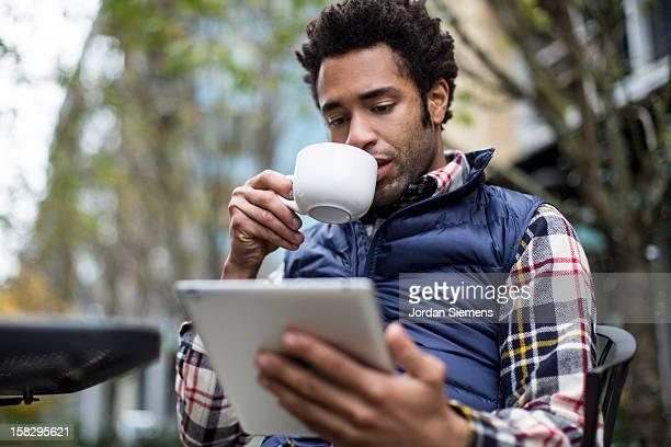 A man using his digital tablet.