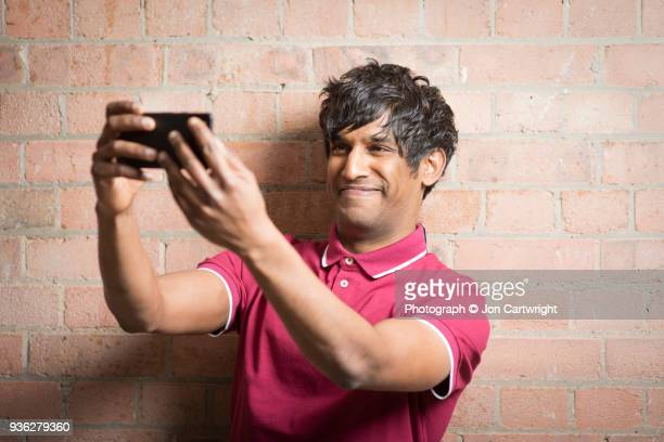 Man using his phone to take a selfie