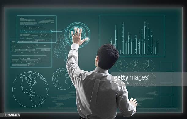 Man using hi-tech computer monitor