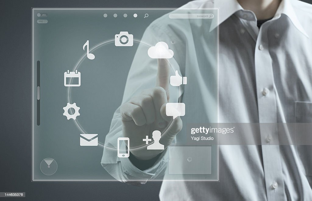 Man using hi-tech computer monitor : Photo