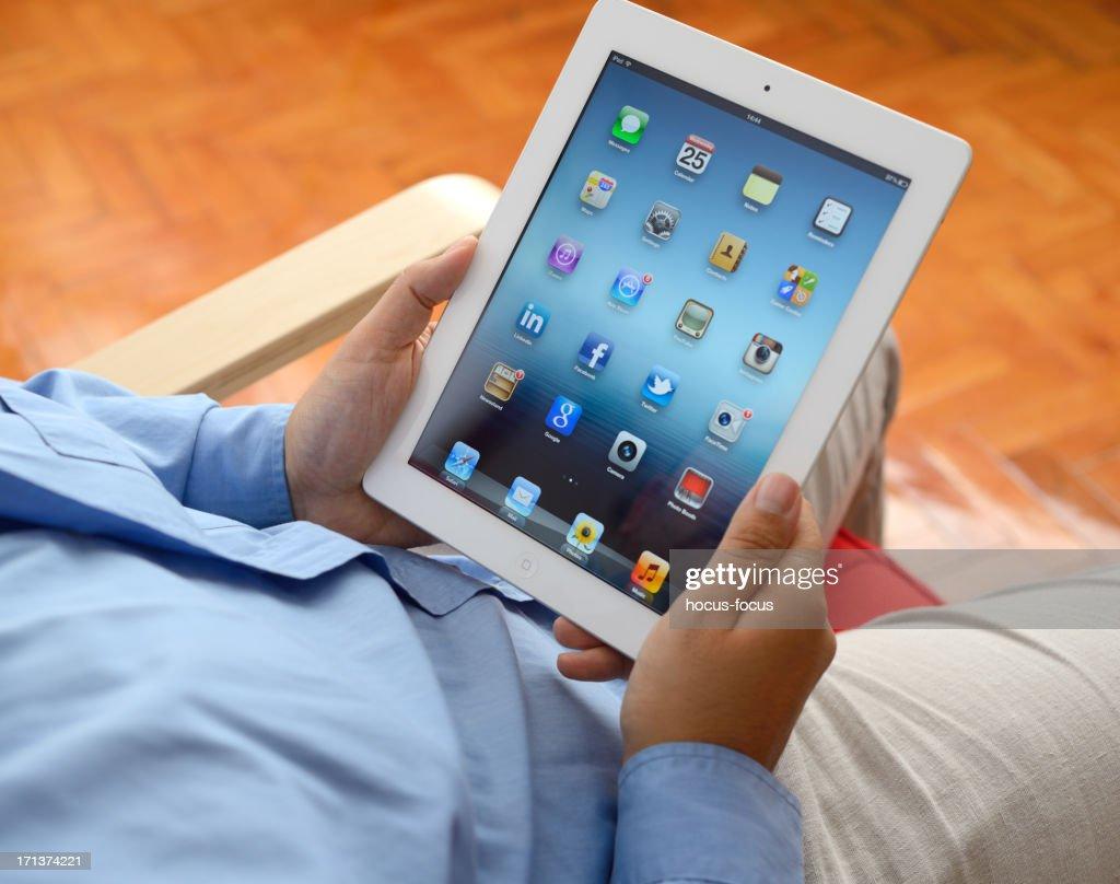 Man using iPad 3 : Stock Photo