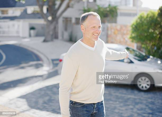 man using keyless lock on car in driveway - unlocking stock pictures, royalty-free photos & images