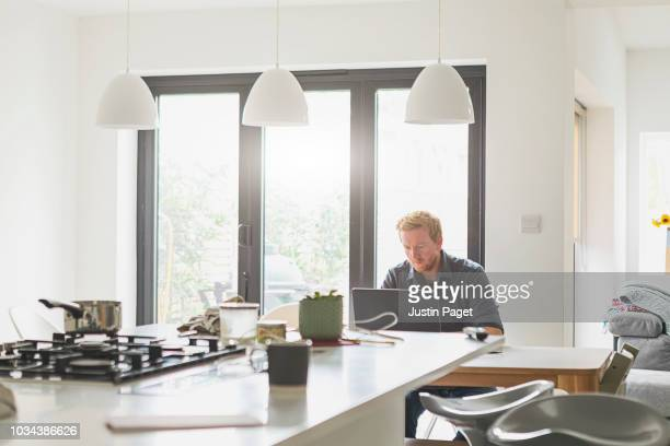 man using laptop at home - sliding door stock pictures, royalty-free photos & images