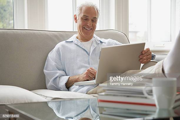 Man using laptop computer on couch
