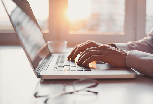 Man using laptop computer 590062300