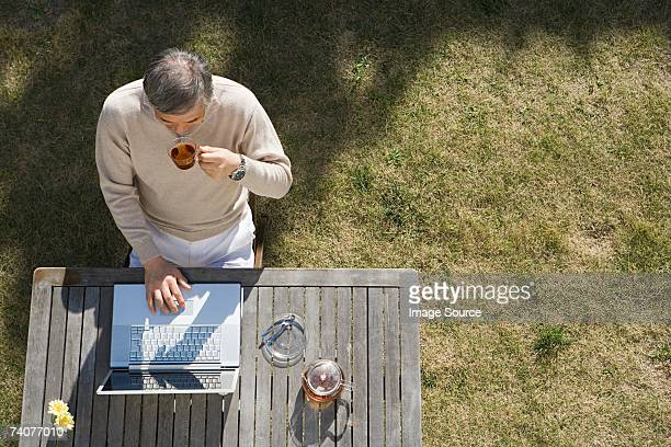 man using laptop computer - only senior men stock pictures, royalty-free photos & images