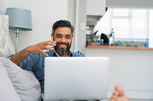 Man using laptop for video call 1088347334