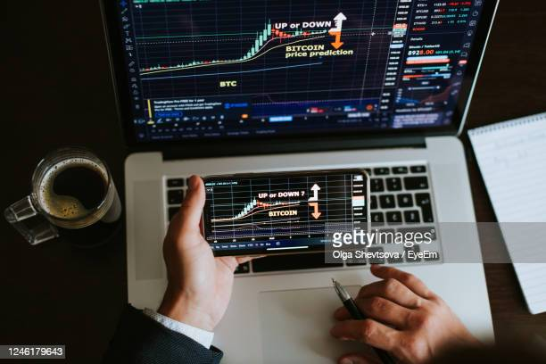 man using laptop on table - cryptocurrency stock pictures, royalty-free photos & images