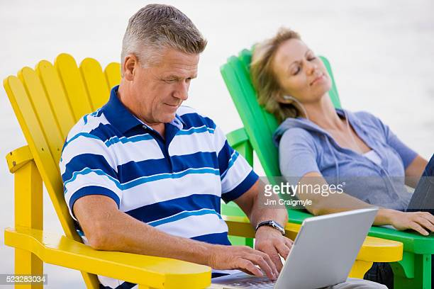 man using laptop outdoors - jim craigmyle stock pictures, royalty-free photos & images
