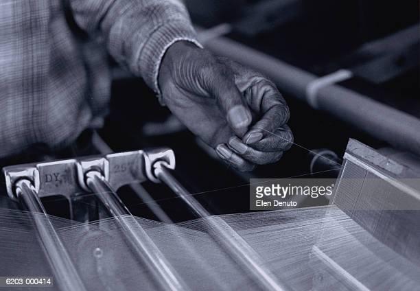 Man Using Loom