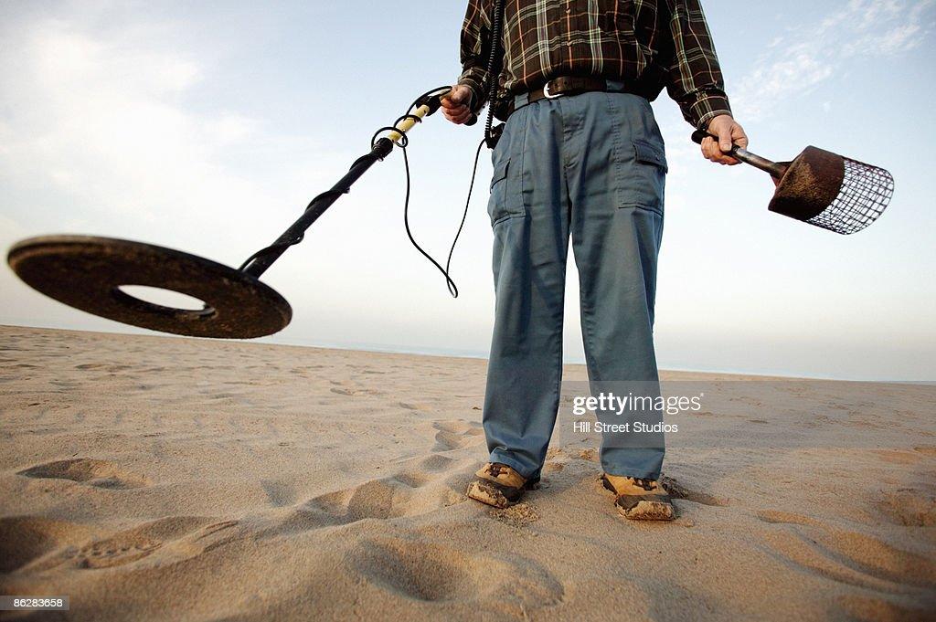 Jew Detector: Man Using Metal Detector At Beach Stock Photo
