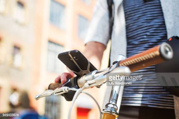 Man using mobile phone on bicycle