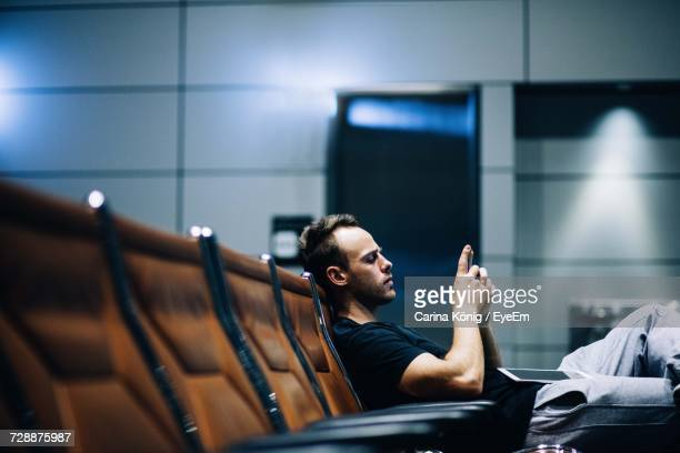 man using mobile phone - waiting stock pictures, royalty-free photos & images