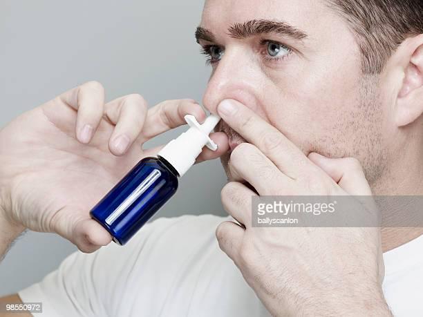Man Using Nasal Spray Inhaler.
