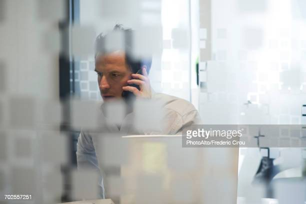 man using office telephone - journalist stock pictures, royalty-free photos & images