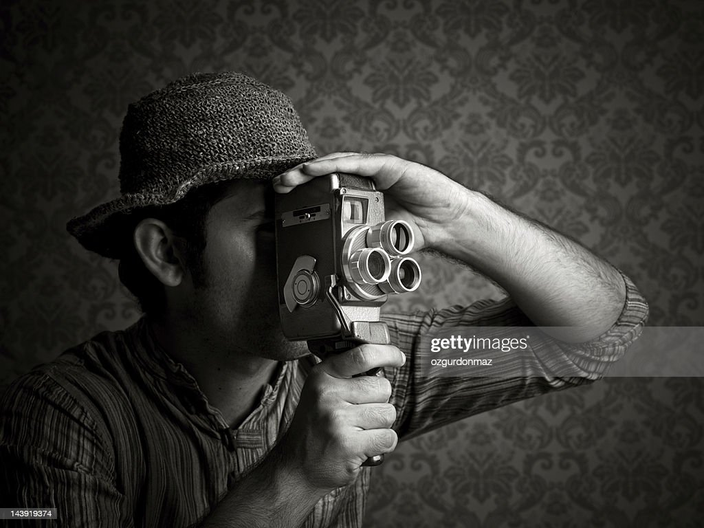 Man using old fashioned cinecamera : Stock Photo