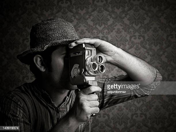 Man using old fashioned cinecamera