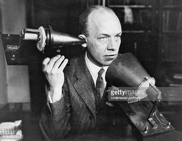 A man using one of Alexander Graham Bell's first telephones circa 1915