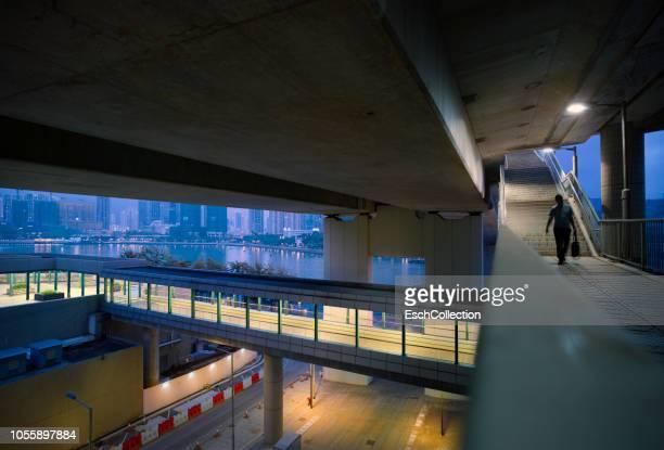 Man using pedestrian underpass in Hong Kong at dawn