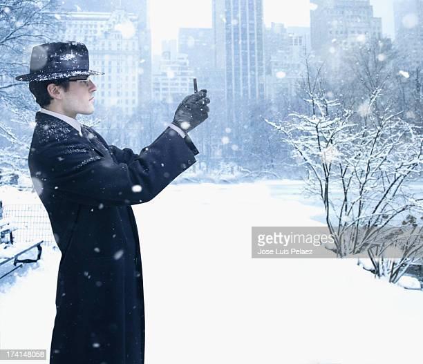 Man using phone camera to photograph winter scenes