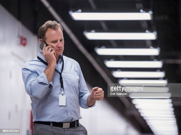 Man using phone in corridor