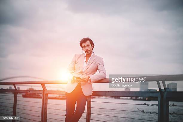 Man using phone in sunset