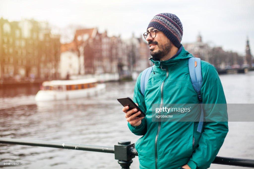 Man using phone outdoor : Stock Photo
