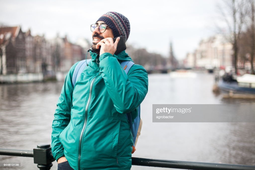 Man using phone outdoor : Stock Photo