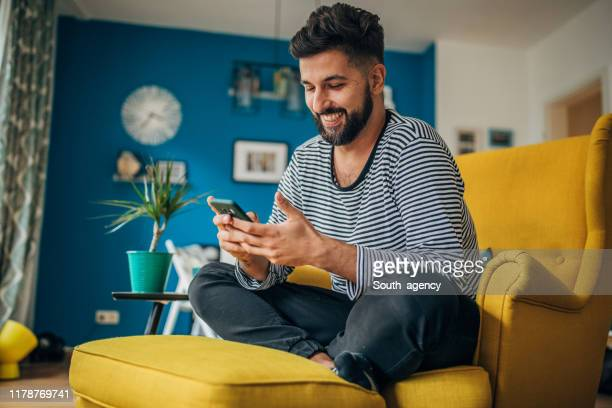 man using phone - mobile phone stock pictures, royalty-free photos & images