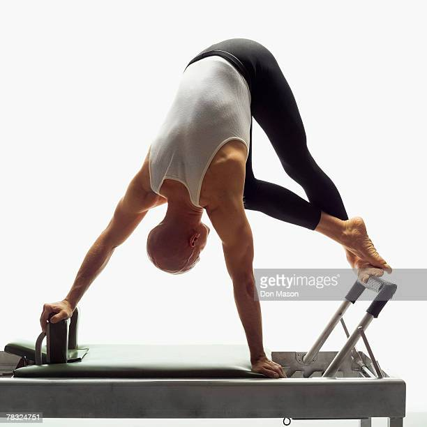 Man using pilates reformer
